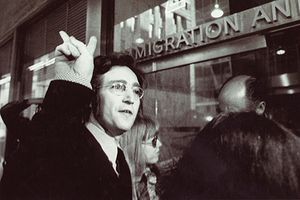John Lennon free as a bird with his green card in front of the Immigration And Asylum Centre