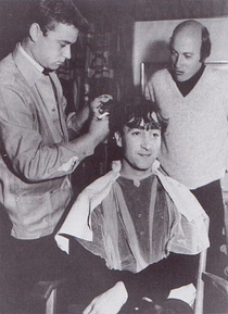 John Lennon smiles whryly as he lost his hair at the hands of German barber, Klaus Baruck, in Germany, for the sake of a film How I Won the War